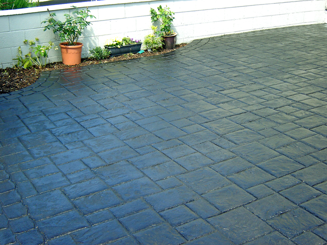Ashlar Slate pattern imprinted concrete paving for driveways with Diamond Crete Limited