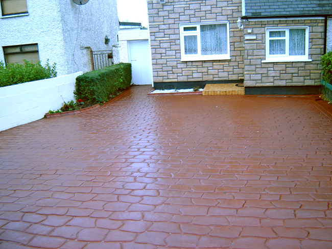 Riverstone pattern imprinted concrete paving for driveways with Diamond Crete Limited